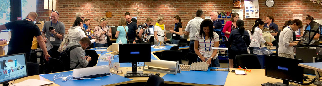 panoramic view of people in Makerspace using equipment